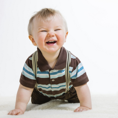 Baby boy crawling at Douglas L. Park, DDS, Pediatric Dentistry