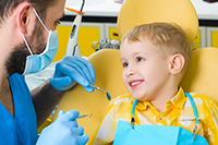 Child dental patient receiving Frenulectomy Treatment at Douglas L. Park, DDS, Pediatric Dentistry