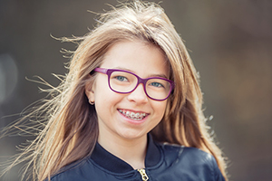 Girl with braces from Douglas L. Park, DDS, Pediatric Dentistry in Gresham, OR.