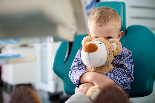 Image of a child with a teddy bear. At Douglas L. Park, DDS, Pediatric Dentistry in Gresham, OR we offer general anesthesia and nitrous oxide sedation to help your child feel comfortable.