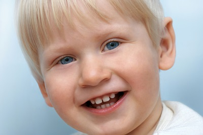 Child Smiling with First Teeth at his visit to Douglas L. Park, DDS, Pediatric Dentistry
